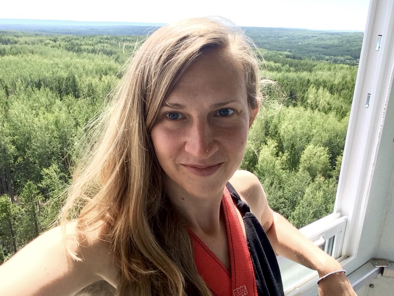 The writer in her perch: a small glass dome in the sky where I can see out for 40 km radius over the boreal forest.